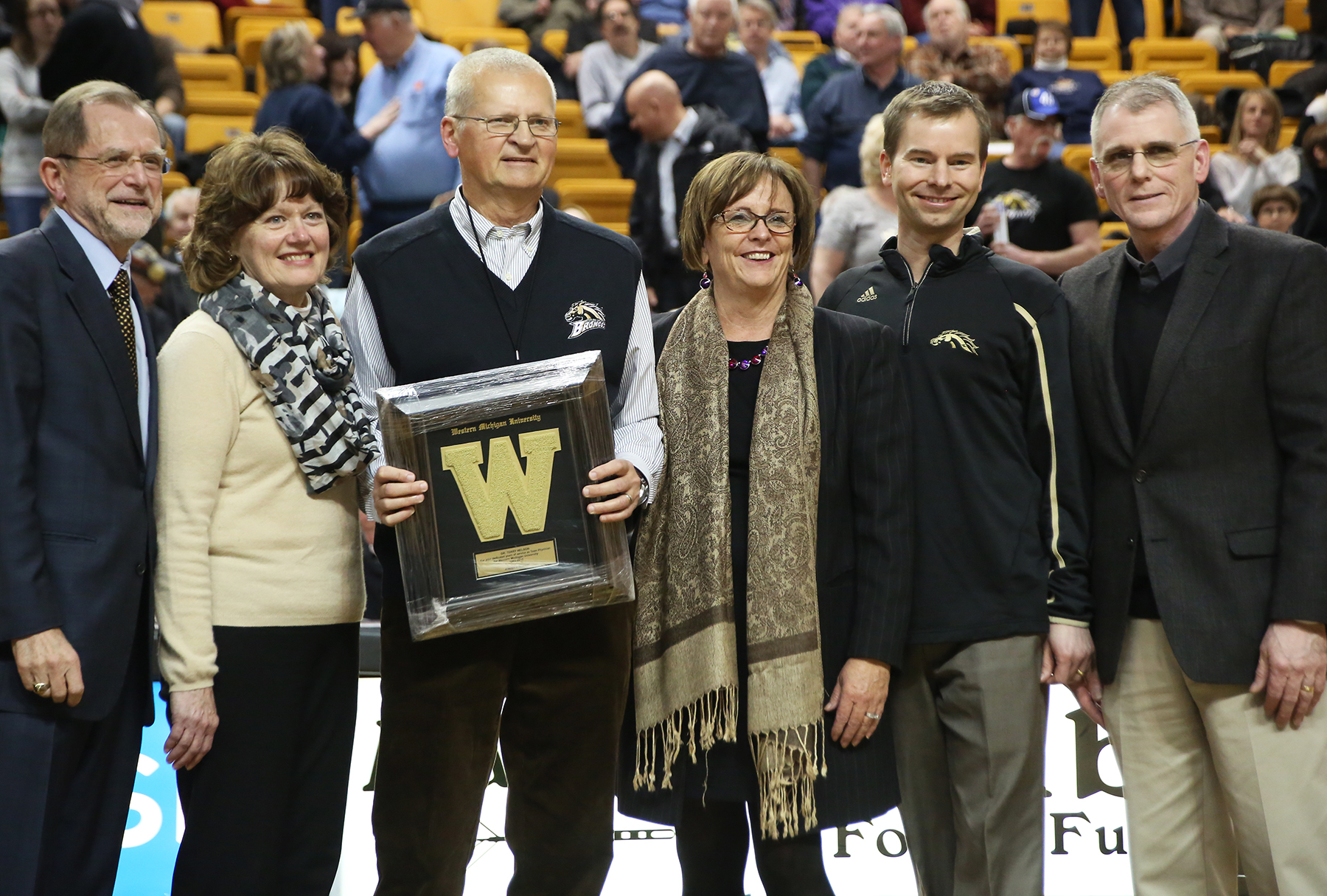 Dr. Terry Nelson being recognized at WMU basketball game