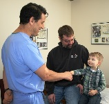 Cooper Roggelien shakes Dr. Highhouse's hand