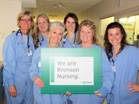 "Nurses holding a ""We are Bronson Nursing"" poster"