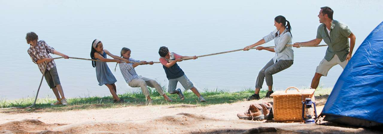 Image of family playing tug of war.