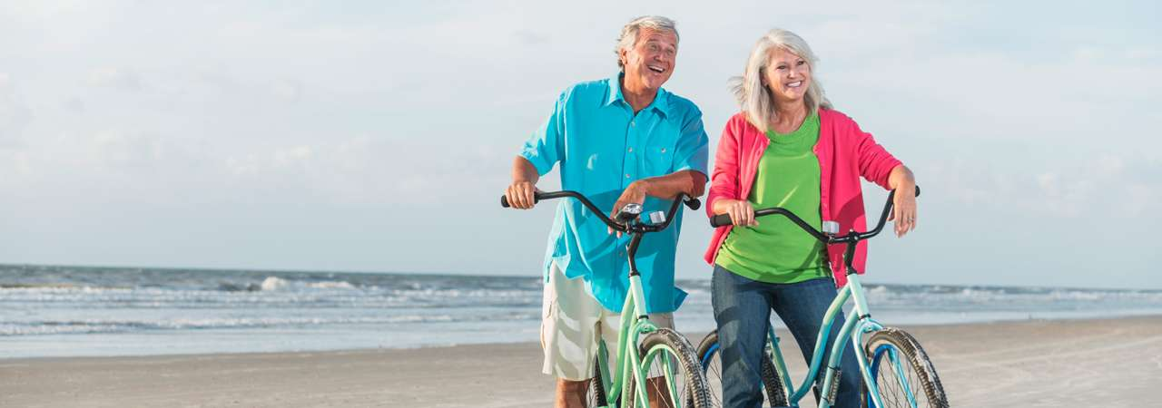 Image of man and woman on bikes.