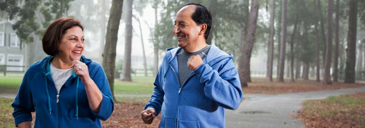 Image of senior Hispanic couple jogging.