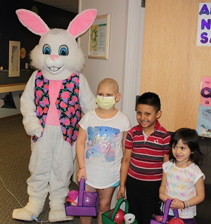 Photo with person in Easter bunny costume with your patients from Bronson Children's Hospital.