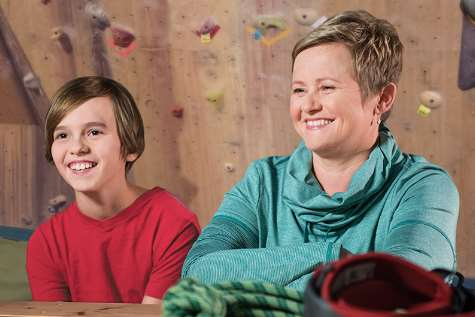 Photo of Ben and his mom at a rock climbing center.