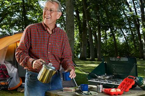 Photo of Don camping outdoors.