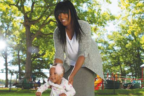 Photo of Jeanetta playing with her daughter outdoors.