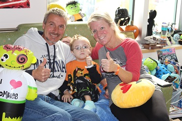 Family during the Bronson Children's Hospital Halloween Parade