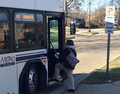Bronson employee gets on the bus, free of charge, as part of the hospitals' Bus2Work program.