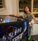 Child at pinball machine