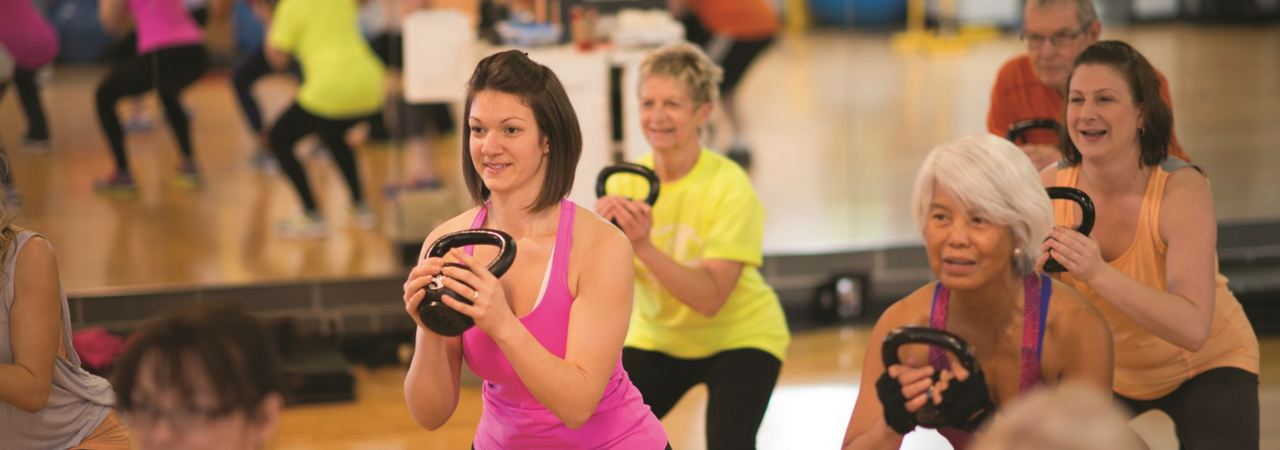 Image of group working out with kettlebells