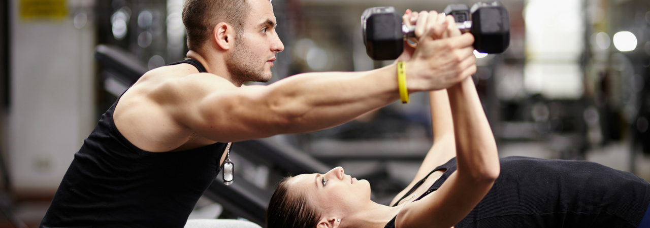 Image of personal trainer working with a client