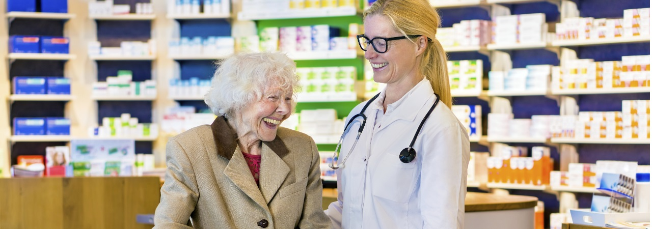 Photo of woman speaking to pharmacist.