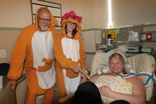 Dr. Seth Malin and NICU Graduate dressed as kangaroos, with Patient and Baby