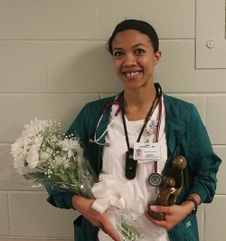 Latisha Long holds her DAISY Award during Nurses' Week celebration