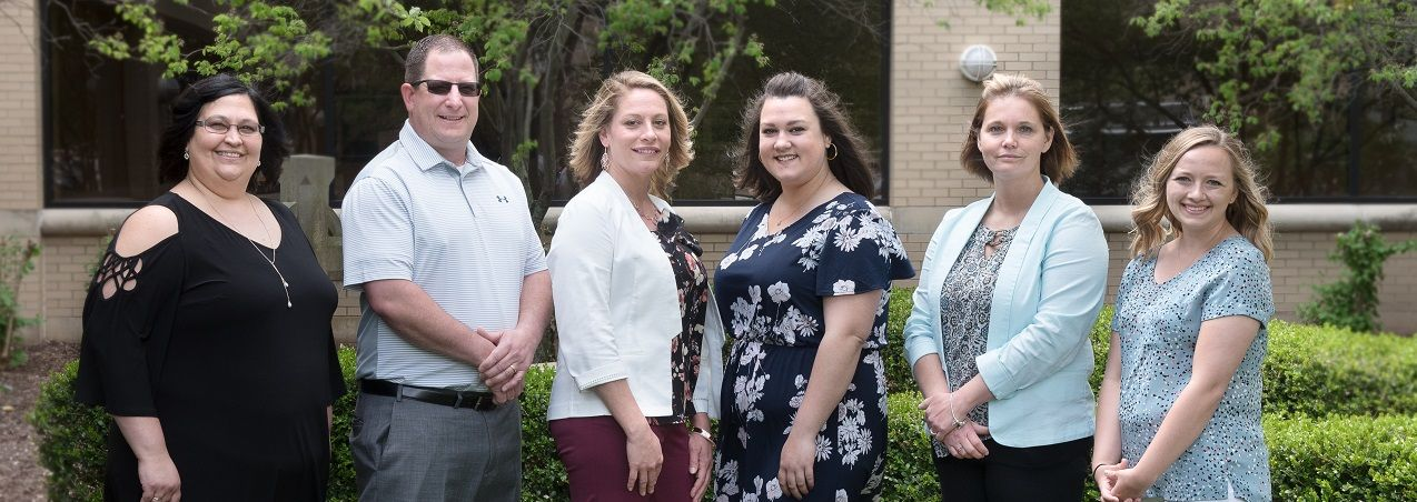 Six Bronson Battle Creek Nurses who received Awards during 2018 Nurses Week pose outside the hospital