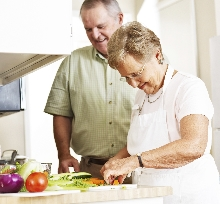 older couple cooking dinner
