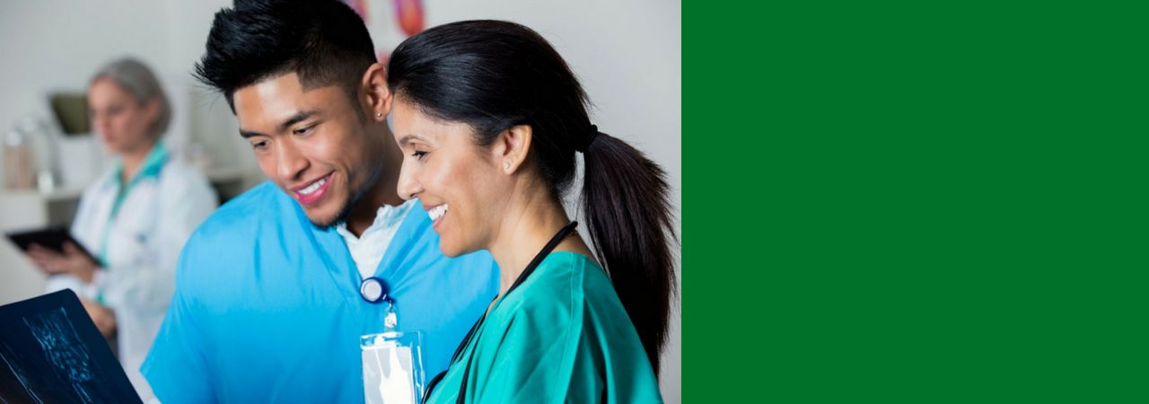 Photo of two nurses collaborating.