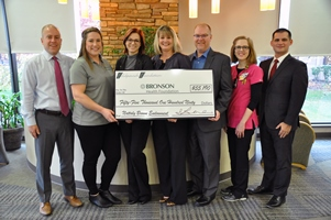 People holding large check presented to Bronson Health Foundation