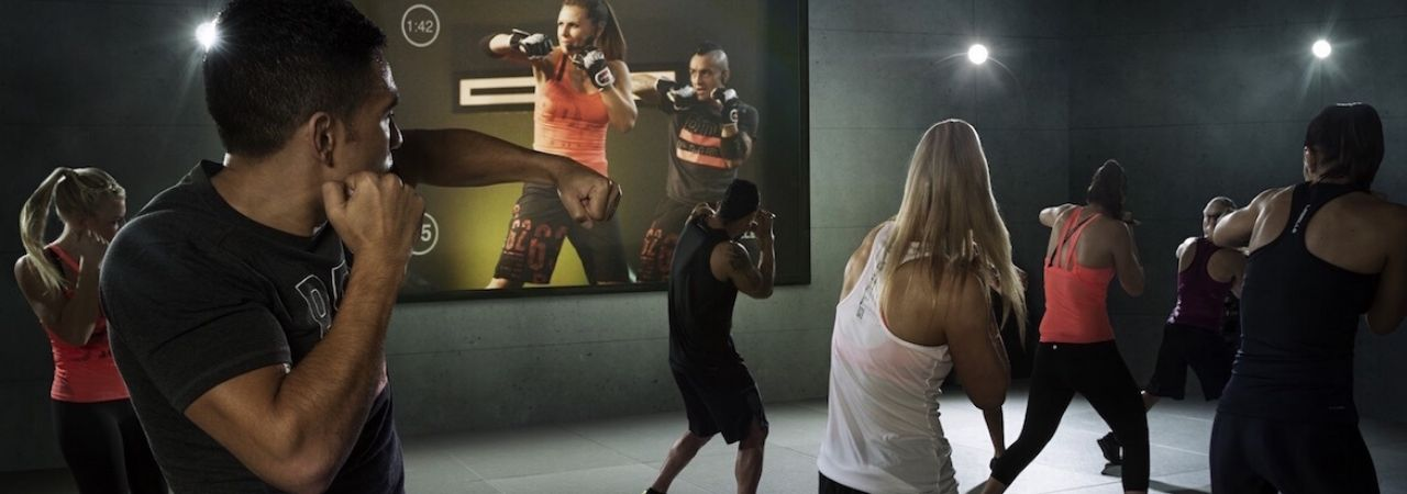 Photo of members participating in a virtual Les Mills class