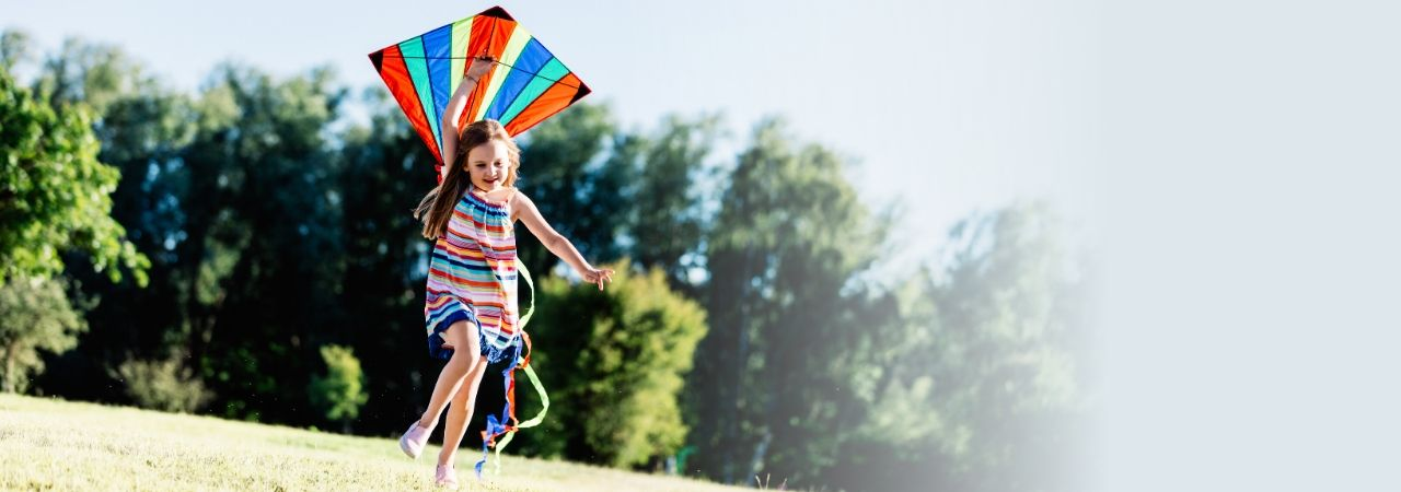 Image of young girl flying a kite